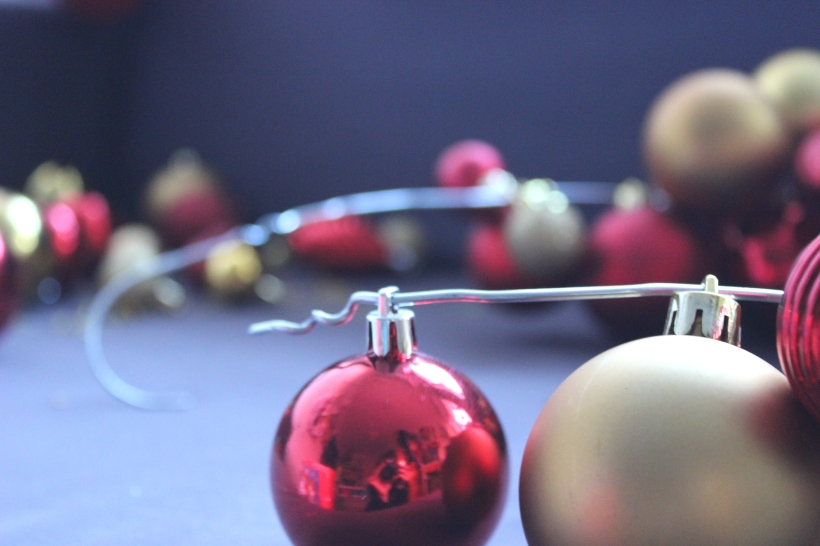 Feeding the baubles into the wire hanger